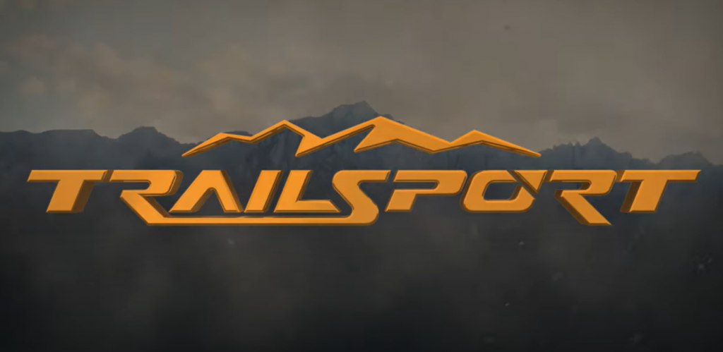 Orange Honda Trailsport logo with mountains in the background