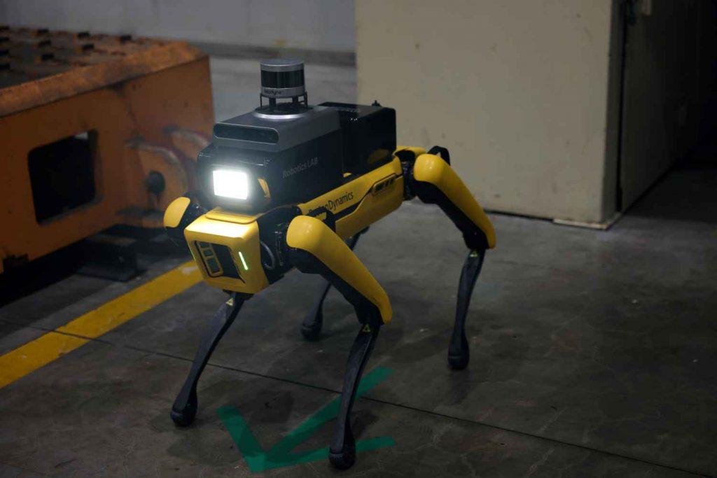 Hyundai Factory Safety Service Robot walking by machine at Hyundai automotive plant