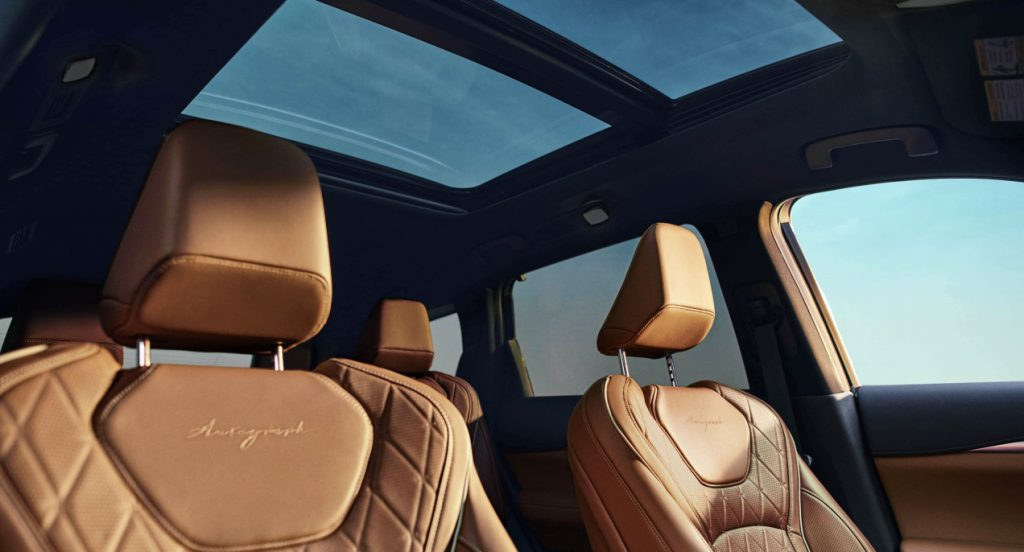 The brown quilted leather seats inside the 2022 Infiniti QX60 luxury SUV.