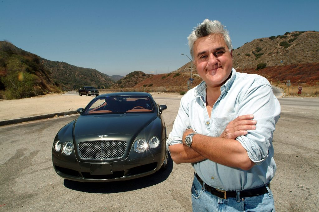 Celebrity car collector Jay Leno stands next to a 2004 Bentley S2 coupe
