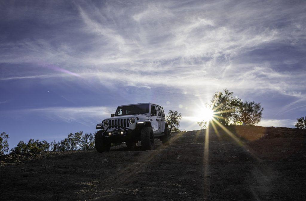 A family enjoys off-roading in a Jeep Wrangler outside of Scottsdale, Arizona, USA.