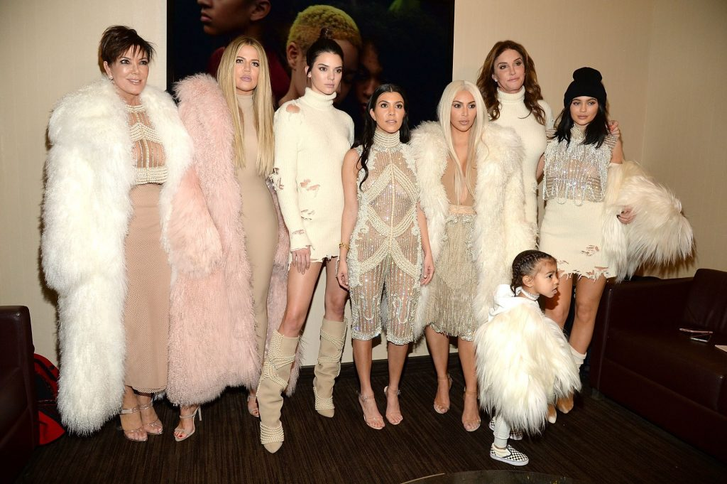 Members of the Kardashian-Jenner family dressed in fur jackets and other high end clothing.