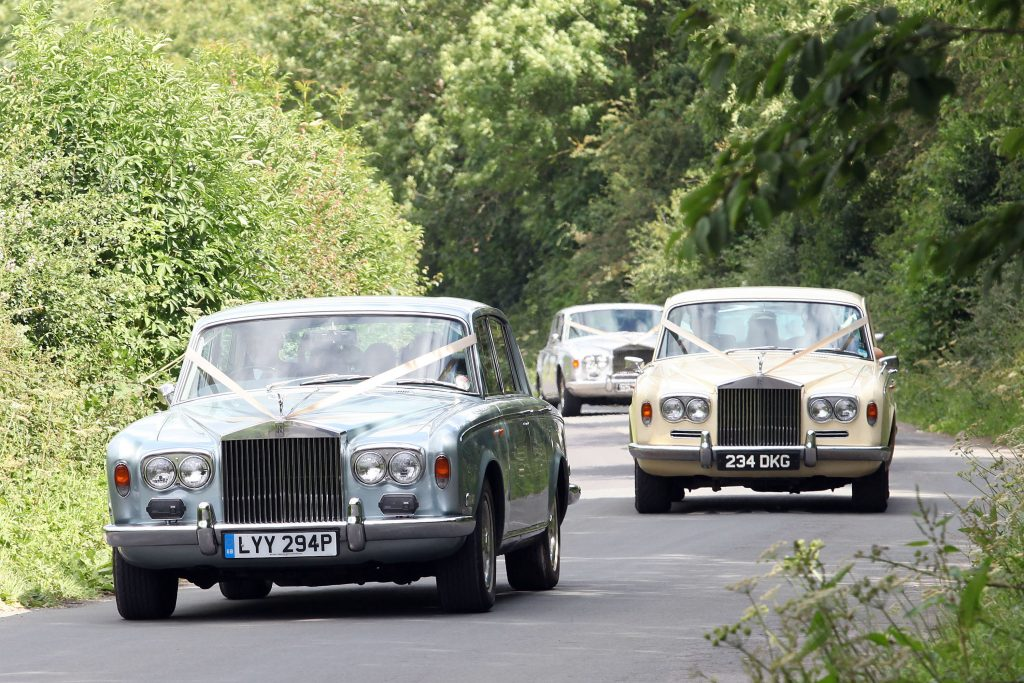 The wedding cars for Kate Moss' wedding sighted arriving at the wedding. These are two cars that belong to kate MOss' insane cool vintage car collection