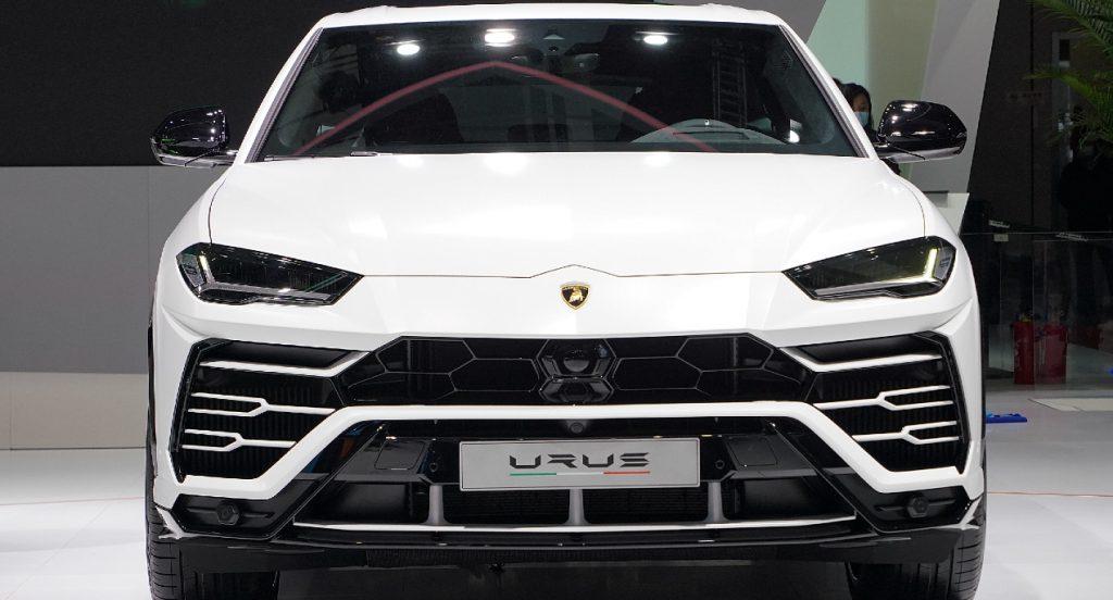 A white Lamborghini Urus SUV is displayed. The Lamborghini Urus is a super sport utility vehicle.