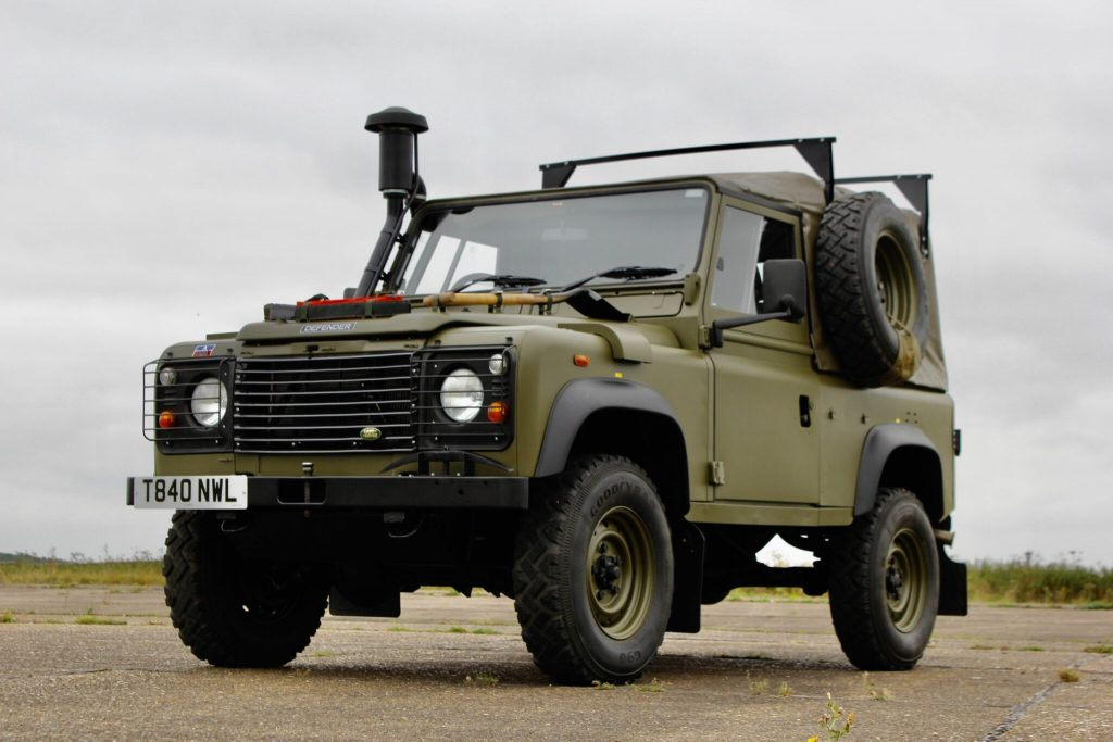One of very few Land Rover Defender Winter Water Wolf parked in the gravel is one of the coolest vintage 4x4 SUVs ever made is for sale