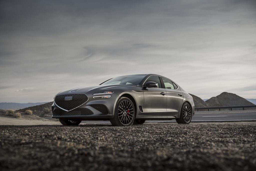 A grey Genesis G70 in the desert