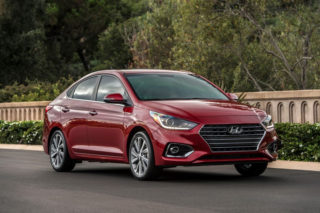 A red 2022 Hyundai Accent sits on the street during the golden hour