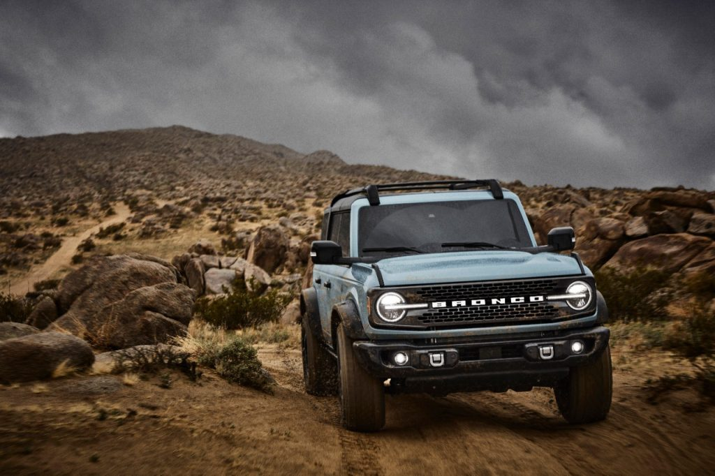 Light blue 2021 Ford Bronco driving on rocky terrain