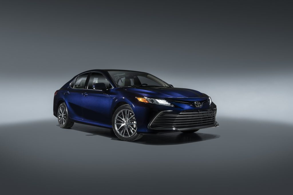 A dark blue 2021 Toyota Camry in a photo booth