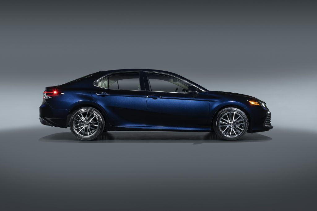 A side profile shot of a dark blue Toyota Camry