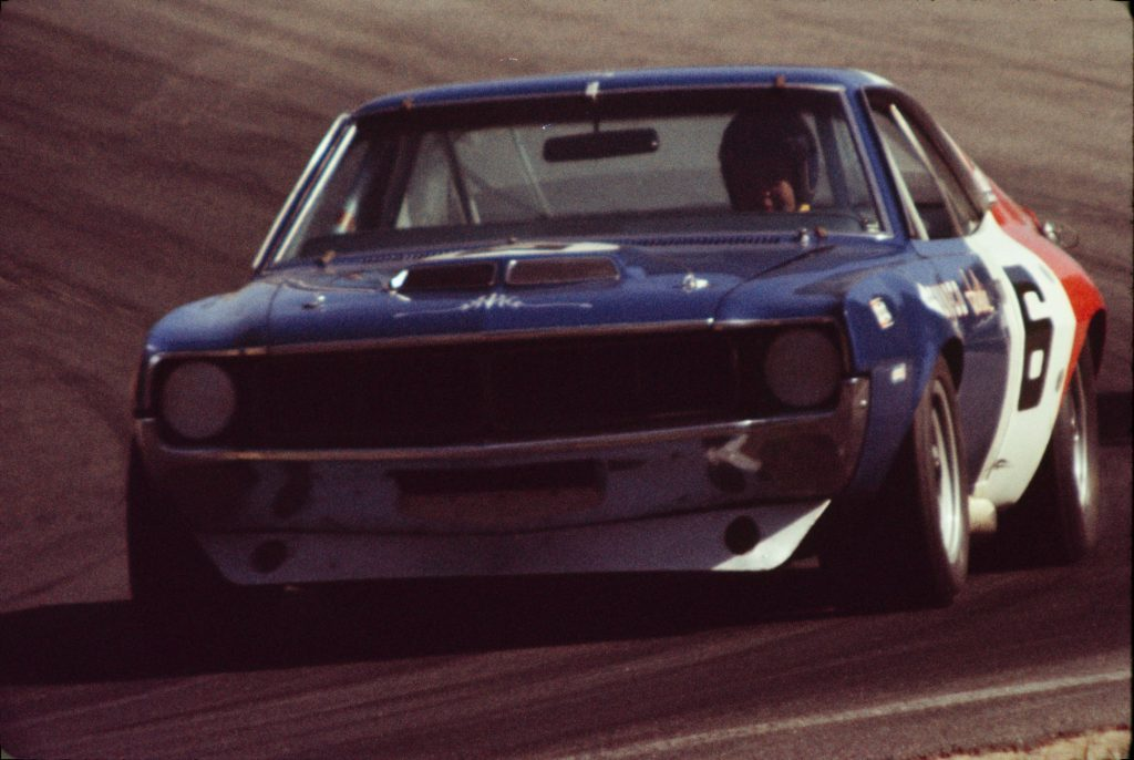 Mark Donohue racing his red-white-and-blue AMC Javelin at the 1970 Laguna Seca Trans Am race