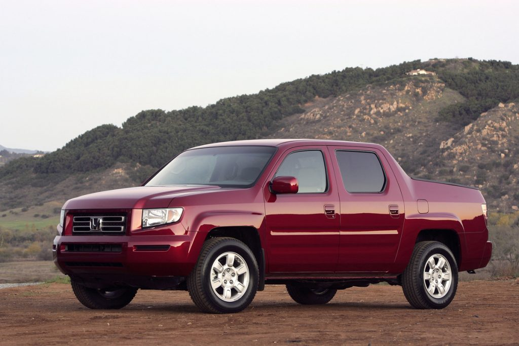 Maroon 2006 Honda Ridgeline with mountains in the background
