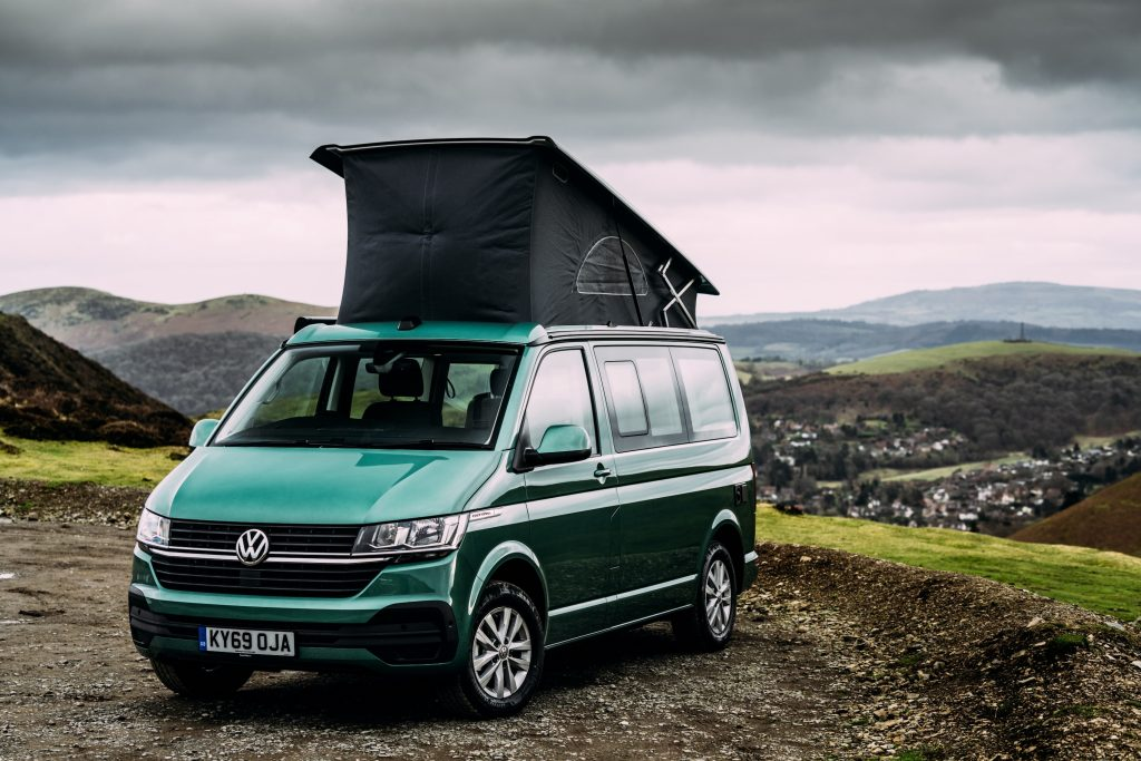 VW camper van with its top popped up