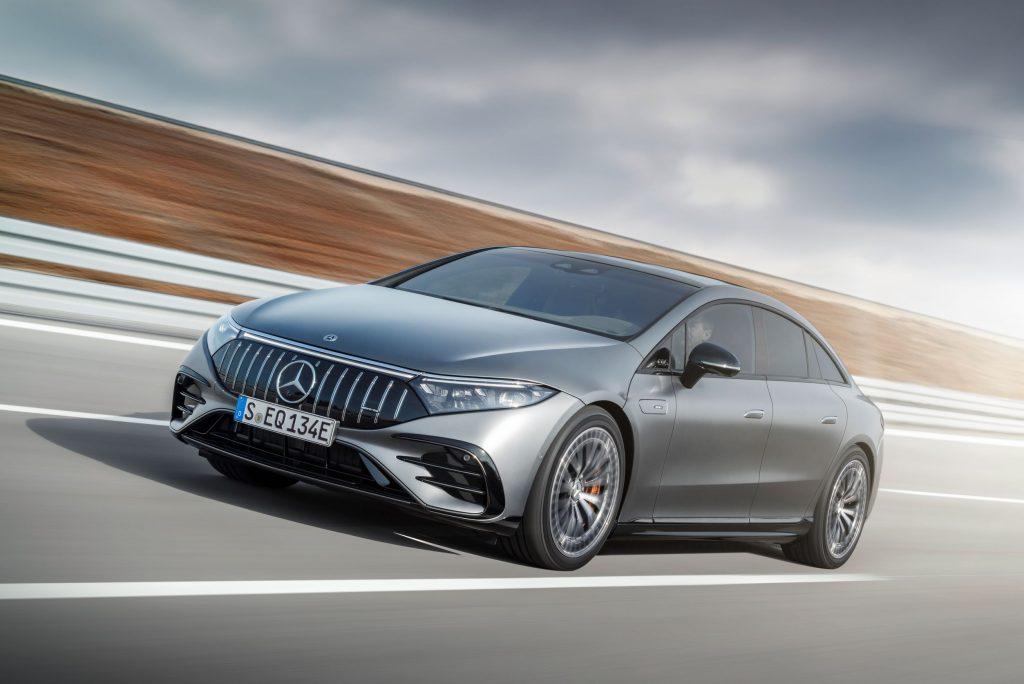 A metallic-gray Mercedes-AMG EQS 43 4Matic+ drives down a road