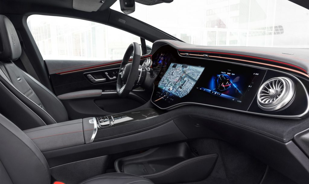 The red-trimmed-black-leather front seats and dashboard of the Mercedes-AMG EQS 53 4Matic+