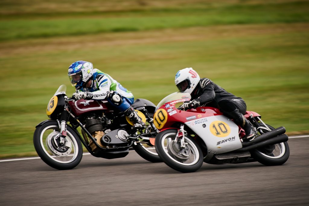 Michael Dunlop on a red-and-silver MV Agusta 500/3 racing Peter Bardell on a maroon-and-black Matchless G50 at the 2021 Goodwood Revival