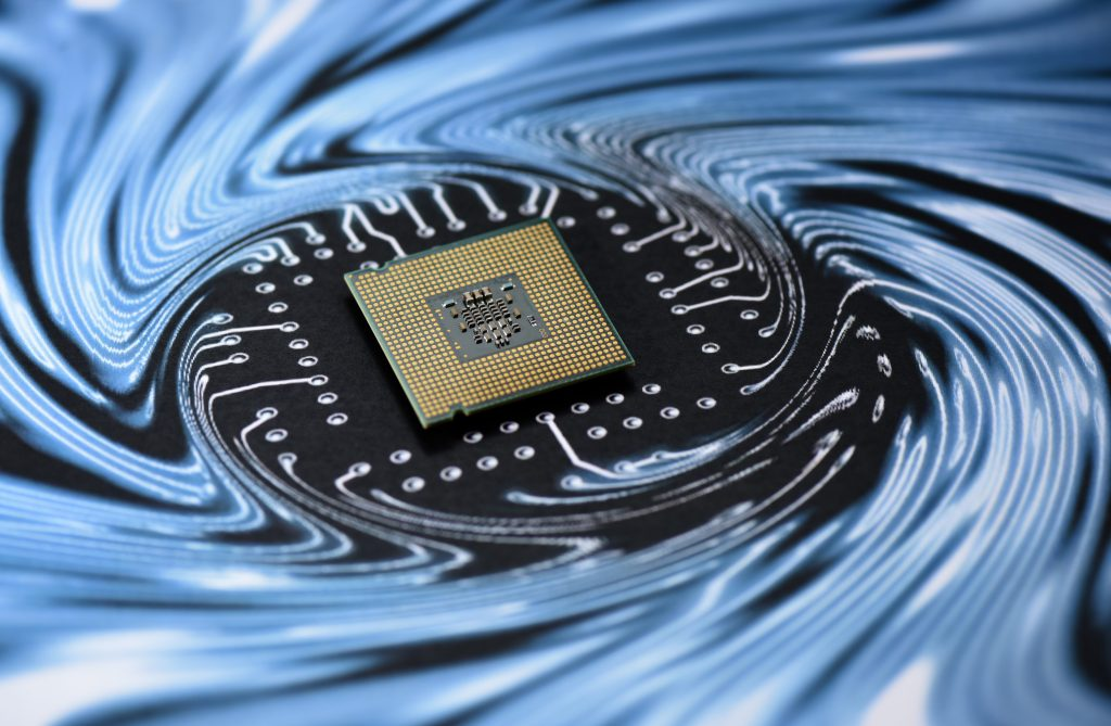 A microchip sitting on a swirling background