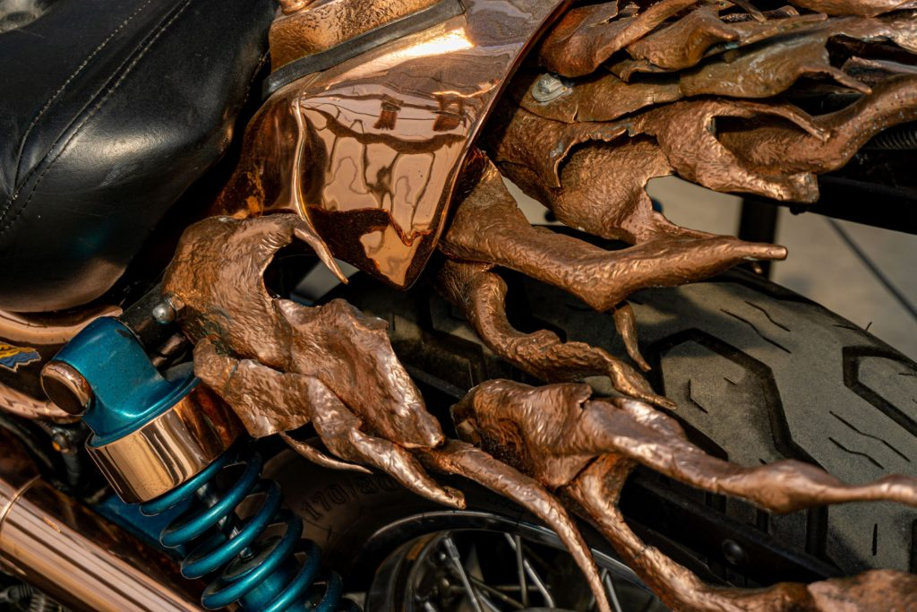 The close-up view of the hand-beaten copper flames at the rear of Mike Prete's custom 1998 Suzuki Intruder