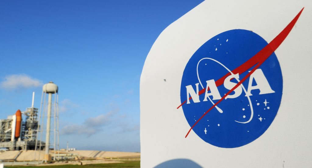 The NASA seal on a protective box for a camera near the space shuttle Endeavour.