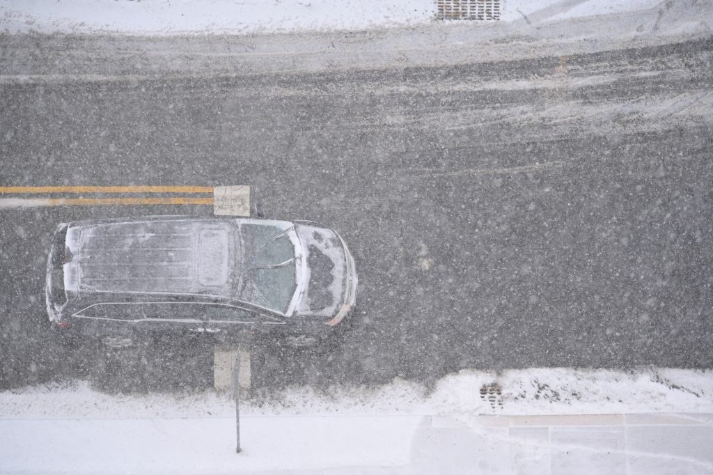 An SUV on a snowy New Jersey road
