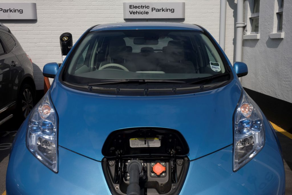 A Nissan Leaf charging in a parking garage at a South London dealership
