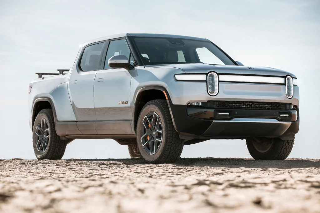 Passenger's side front angle view of gray Rivian R1T electric pickup truck