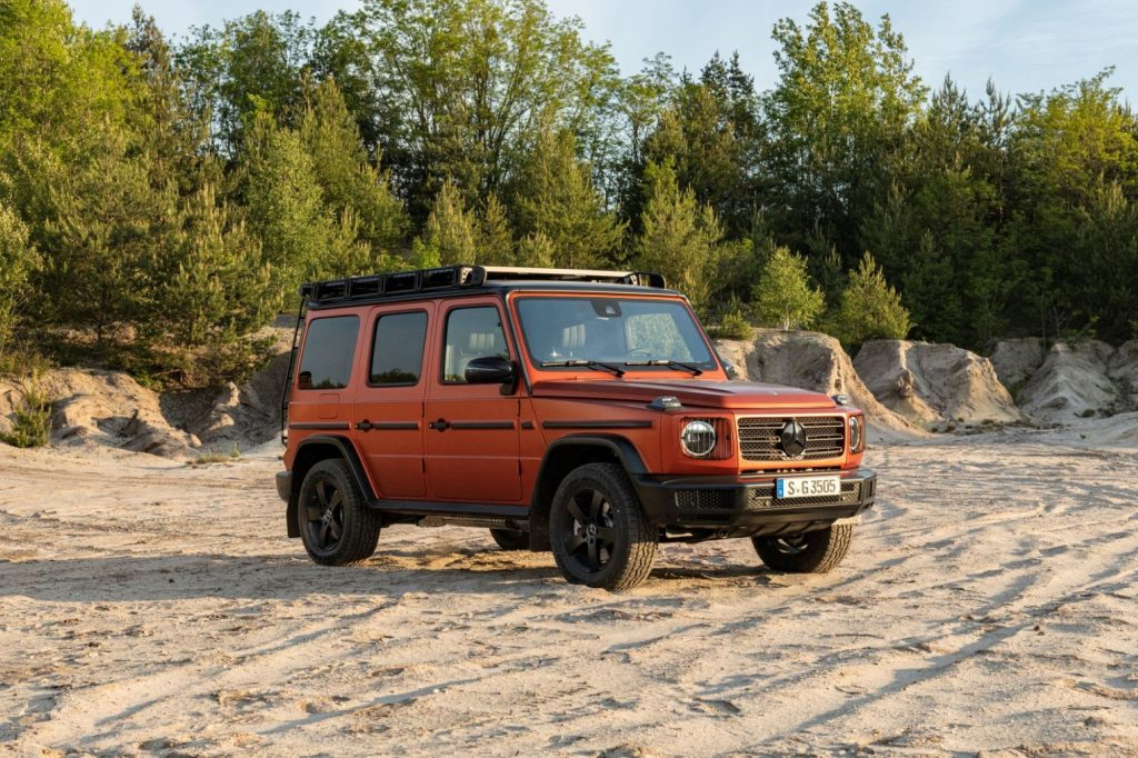 Passenger's side front angle view of orange Mercedes-Benz G-Class Professional Line Exterior