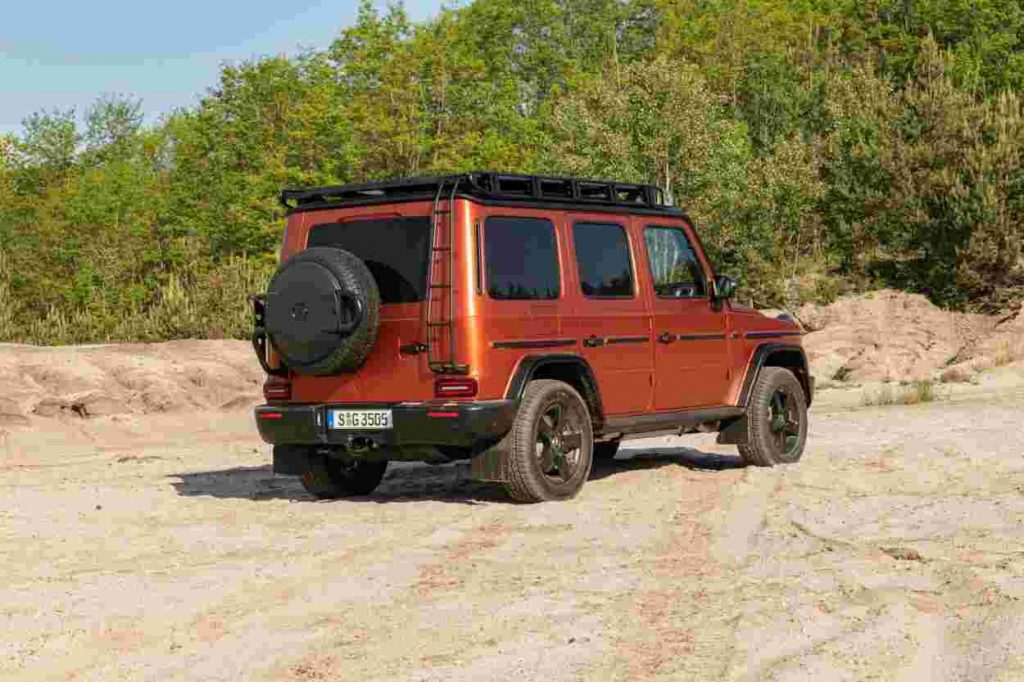 Passenger's side rear angle view of orange Mercedes-Benz G-Class Professional Line Exterior