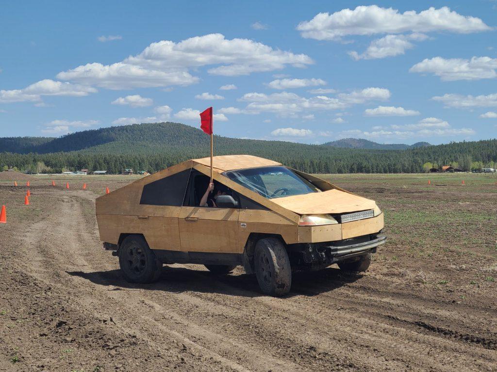 Plybertruck driving on a dirt road