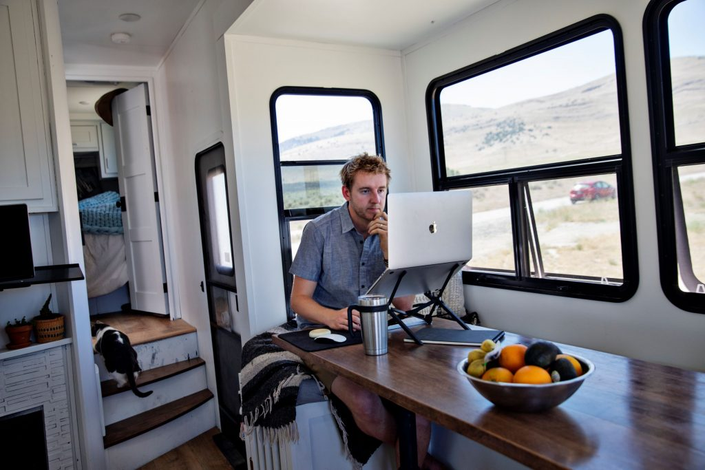 Programmer Kevin Holesh working on his computer using his RV internet