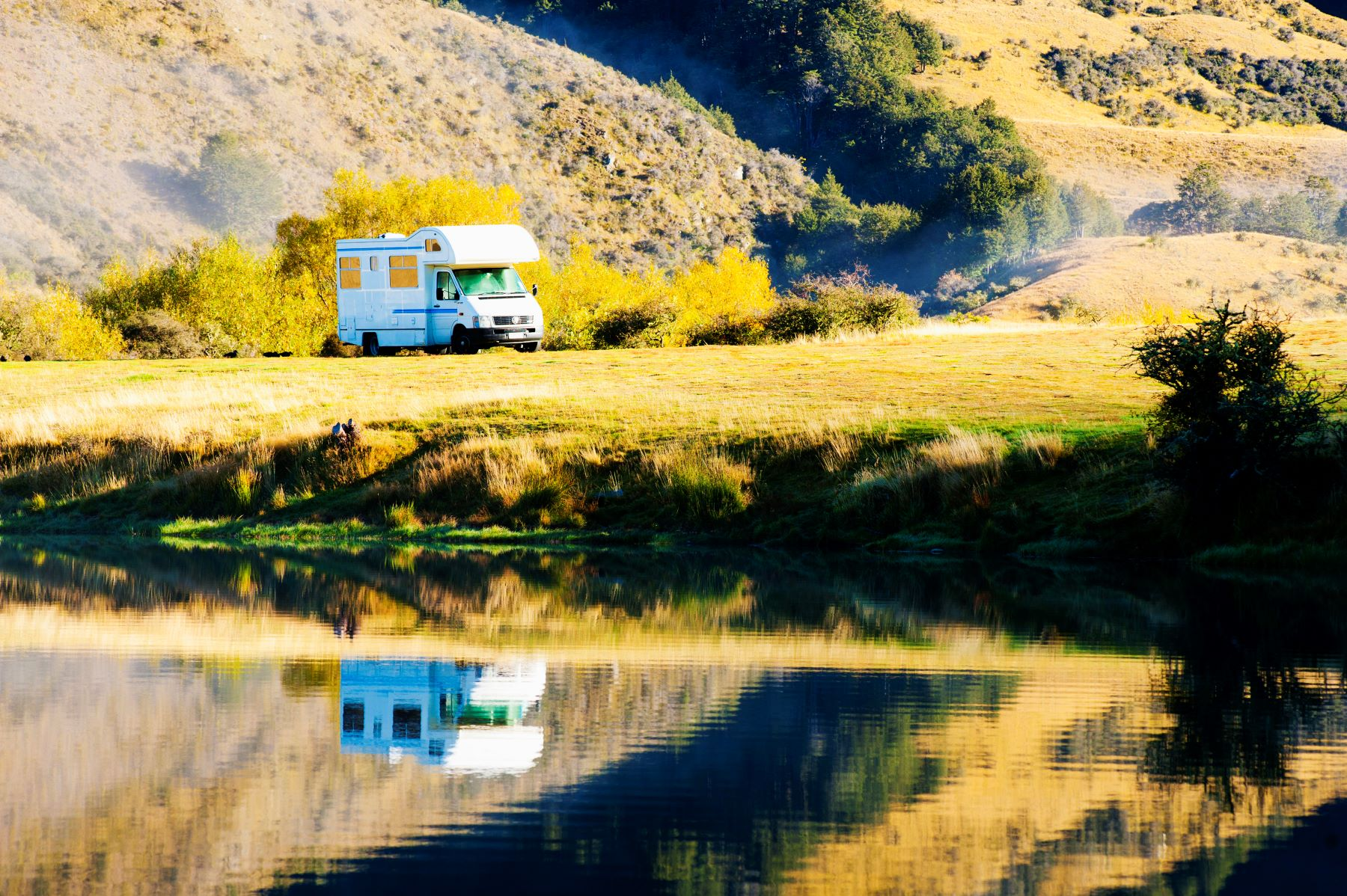 An RV camper parked in at the Lake Moke campsite during fall in Queenstown, South Island, New Zealand