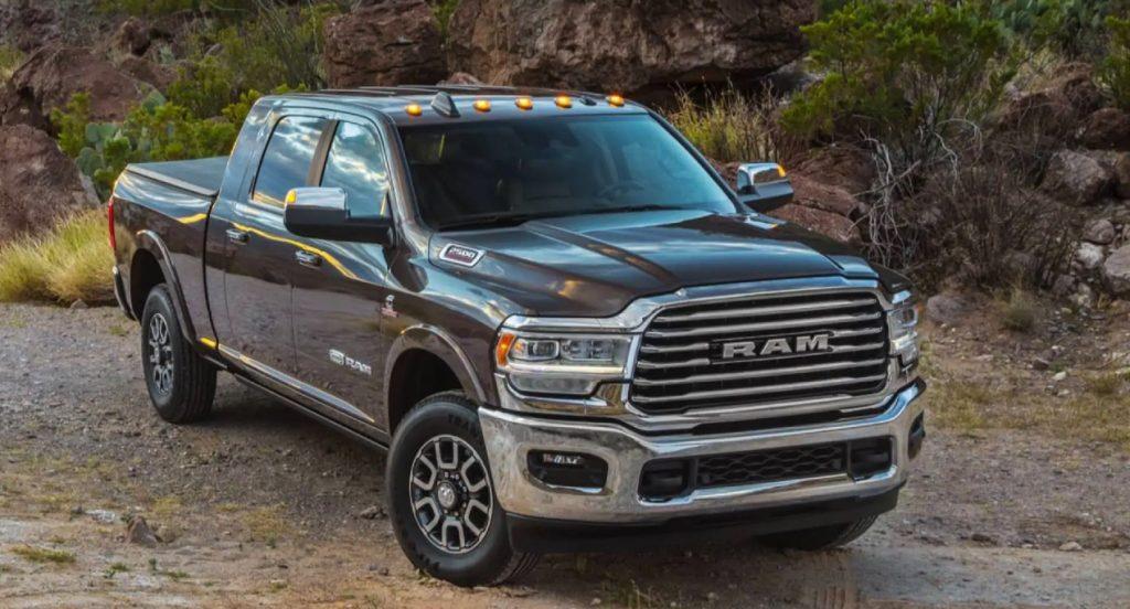 A black 2021 Ram 2500 heavy duty pickup truck is parked near a rocky region.