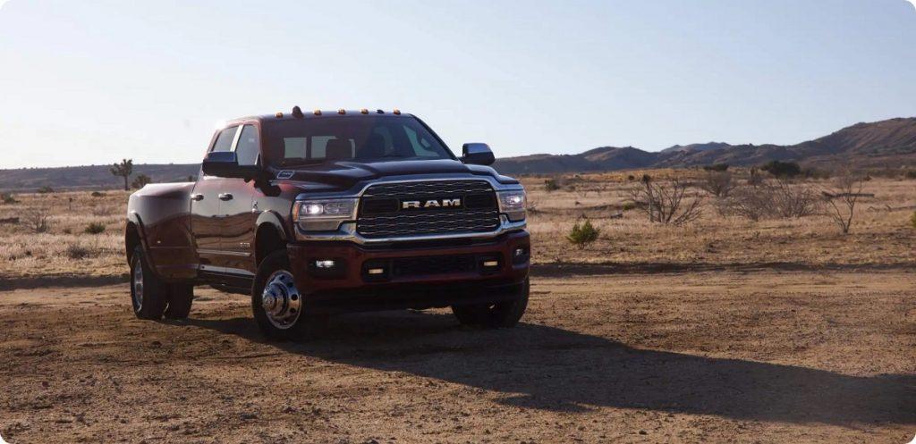 A maroon 2021 Ram 1500 in a desert.