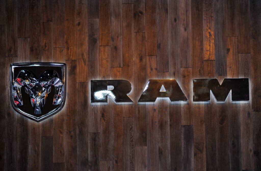 Ram logo against a stained wood background.
