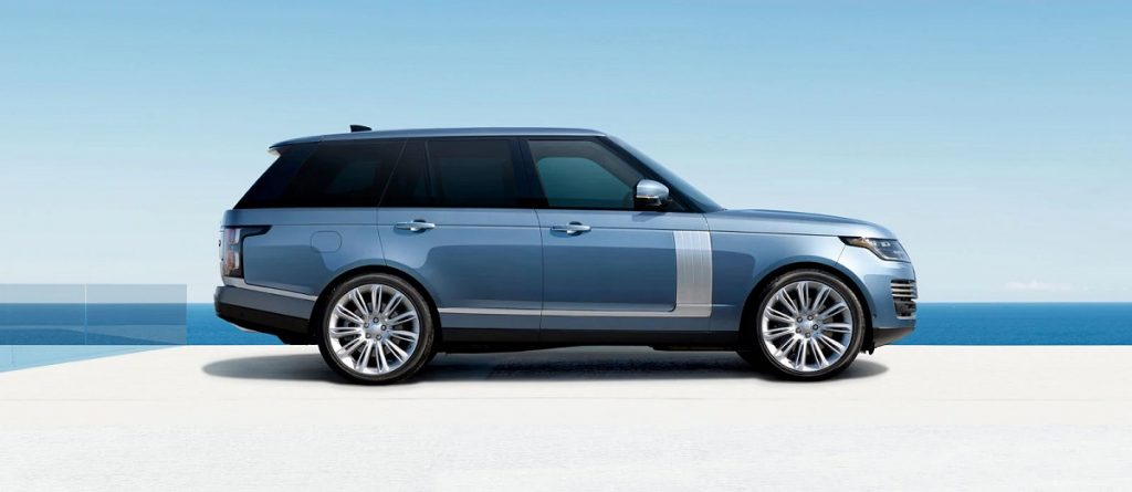 A blue 2021 Land Rover Range Rover at a beach.