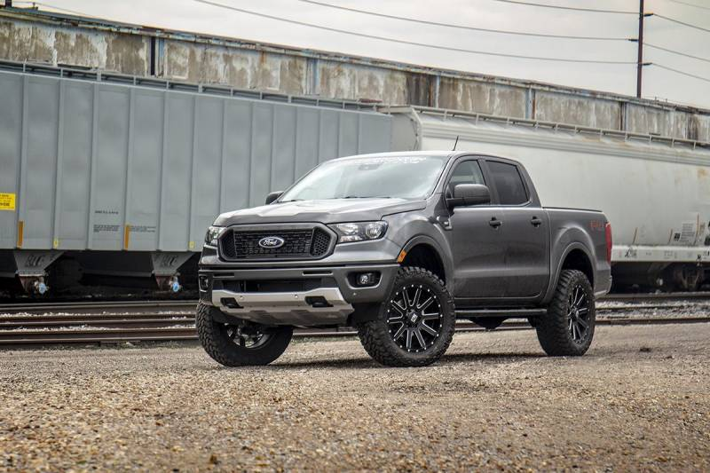 A gray Ford Ranger with a lift kit parked outside
