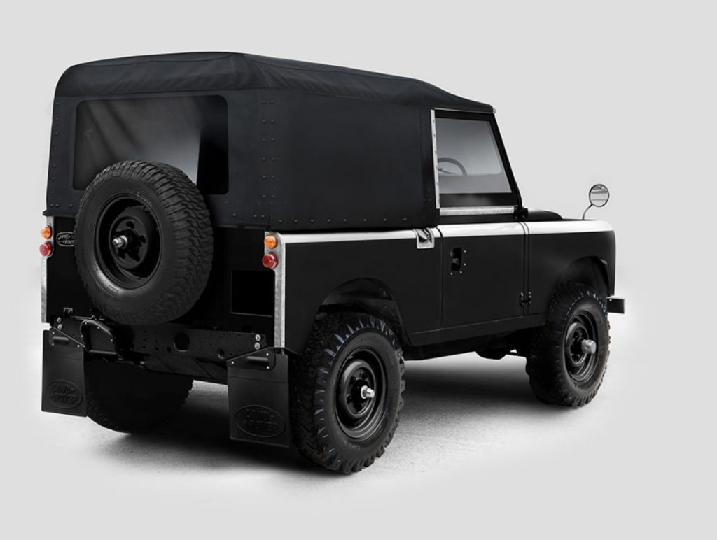 Rear angle view of modified electric black Land Rover Series IIA