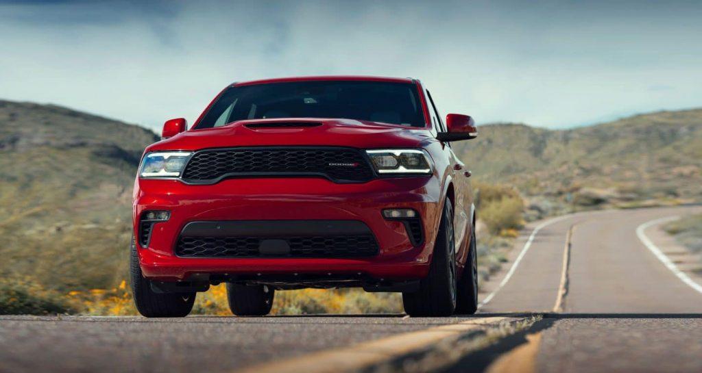 Red 2021 Dodge Durango driving on a desert highway