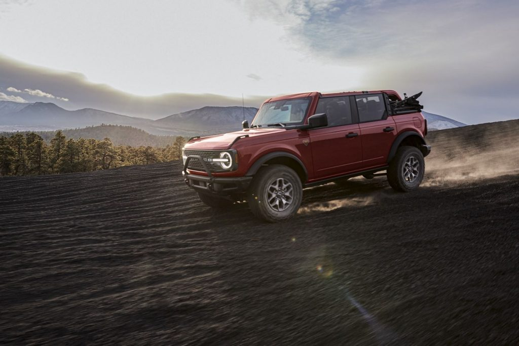 Red 2021 Ford Bronco with mountains in the background