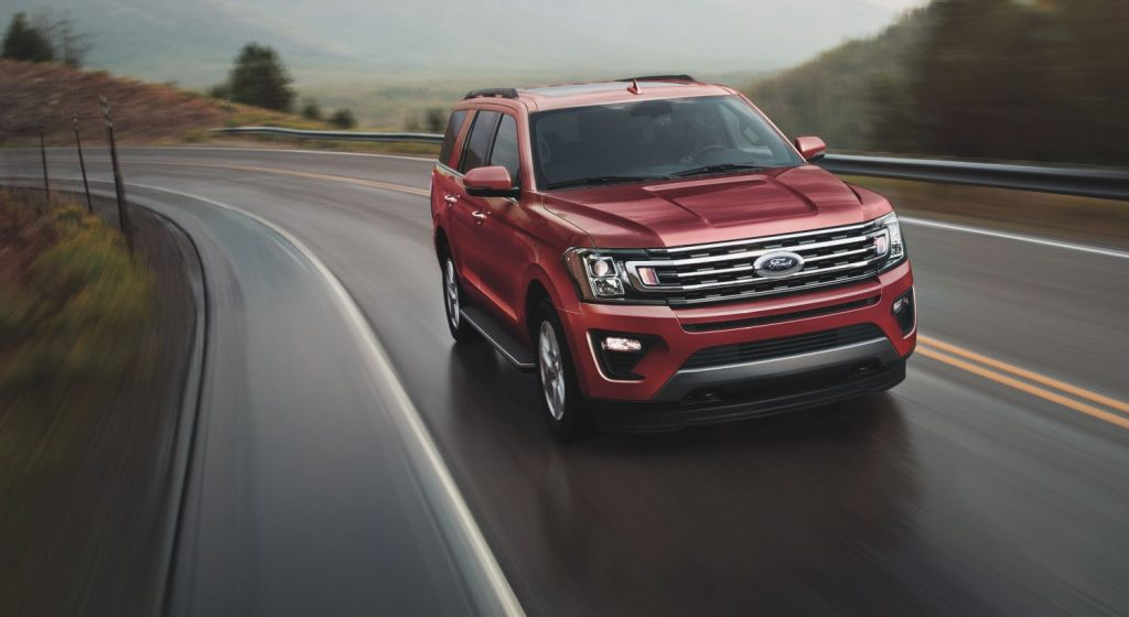 Red 2021 Ford Expedition driving on a mountainous highway