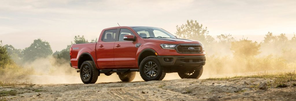Red 2021 Ford Ranger parked in the dirt