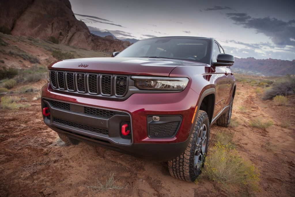 Red 2022 Jeep Grand Cherokee parked on a muddy trail
