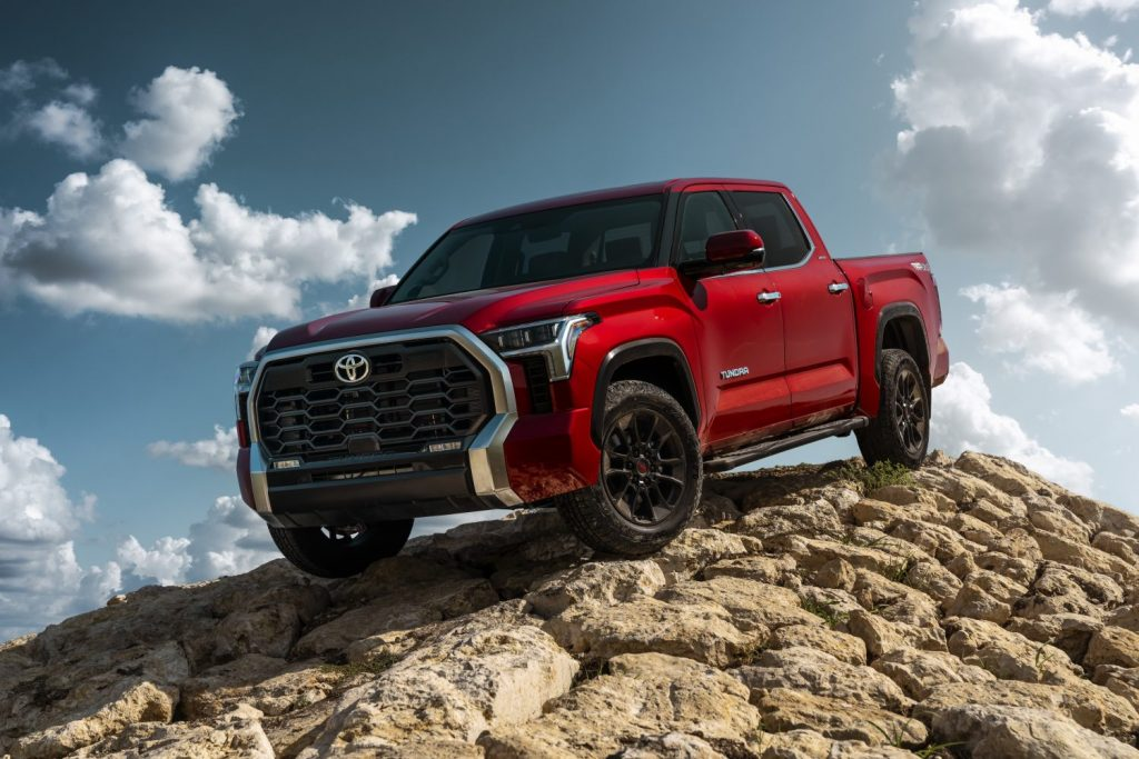 Red 2022 Toyota Tundra parked downward on a slope of a rock pile