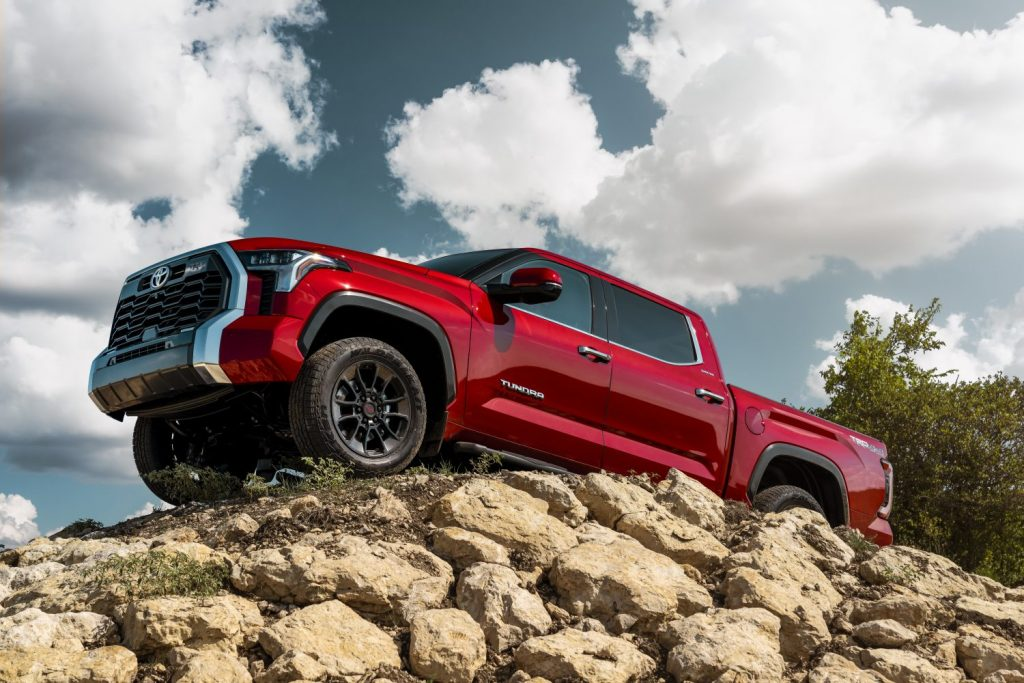 Red 2022 Toyota Tundra parked on a pile of rocks