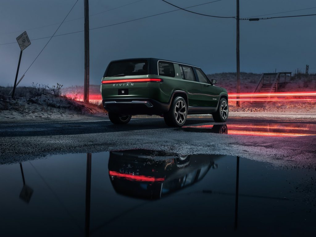 This is a promo photo of a green 2022 Rivian R1S electric SUV, an electric g wagon, budget-friendly