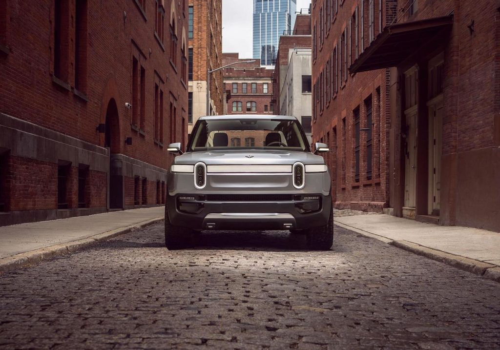 This is a publicity photo of the pre-production 2022 Rivian R1S electric SUV, an electric G Wagon at half the price.