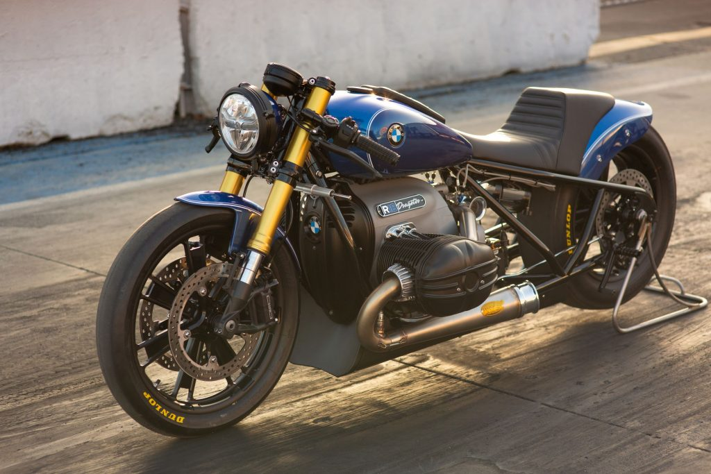 The blue Roland Sands BMW R 18 Dragster on a rear-wheel stand on a dragstrip