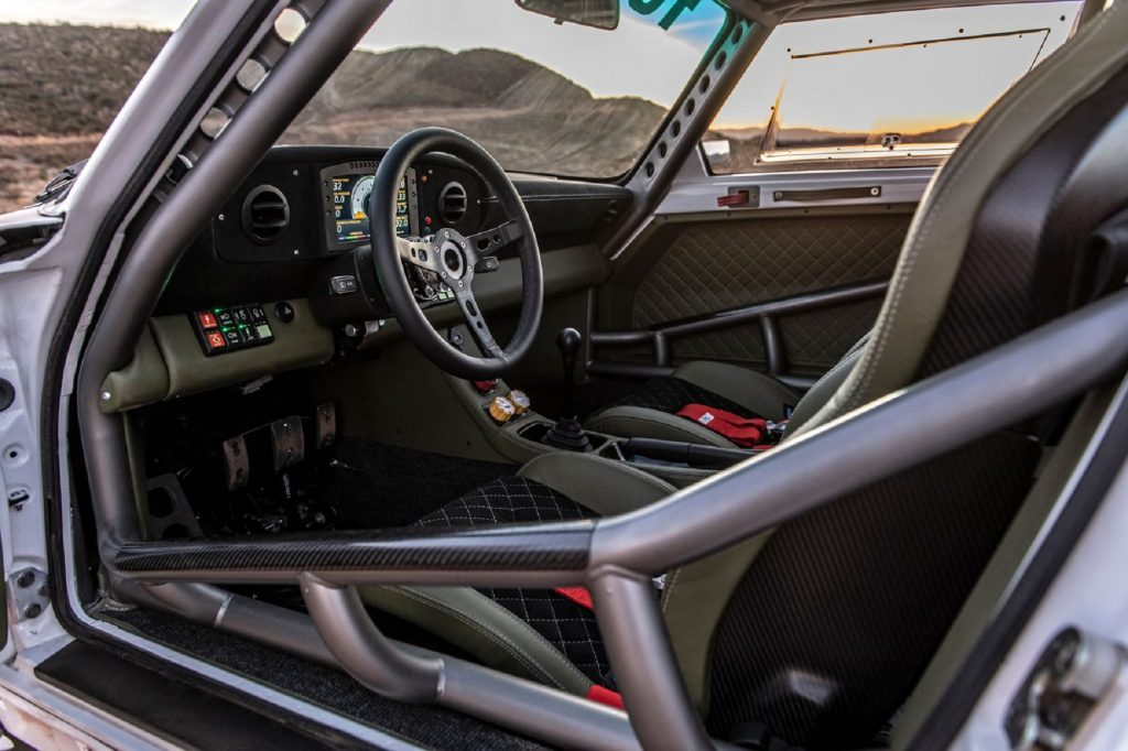 The black-and-green interior with steel roll cage of a Russell Built Fabrications Baja 911