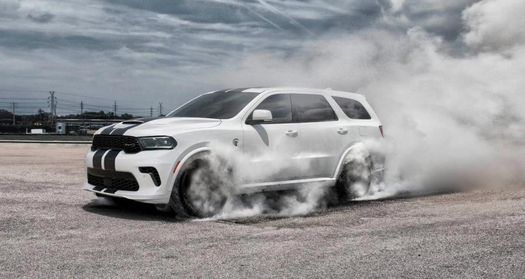 A 2021 Dodge Durango kicking up smoke