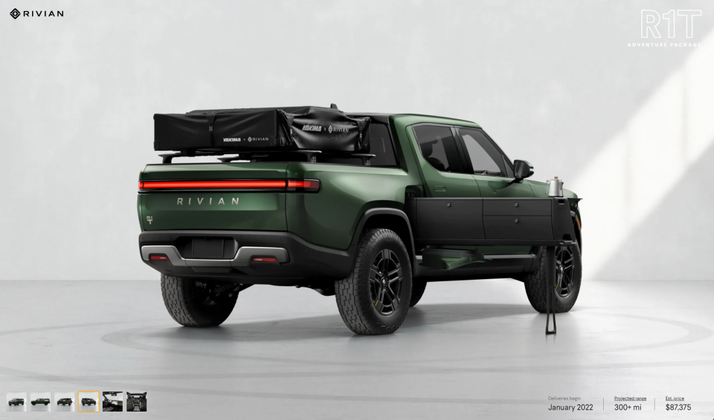 Rivian's R1T truck in forest green with a roof tent and fold-out kitchen